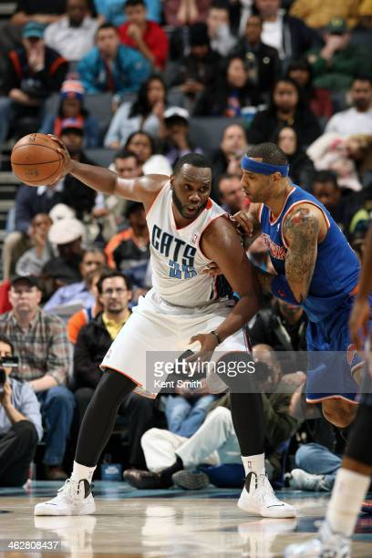 Al Jefferson of the Charlotte Bobcats handles the ball against Kenyon Martin of the New York Knicks at the Time Warner Cable Arena on January 14 2014...