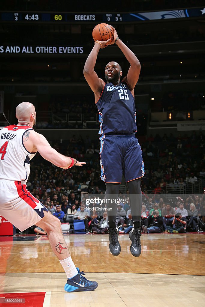 Al Jefferson #25 of the Charlotte Bobcats takes a shot against the Washington Wizards at the Verizon Center on April 9, 2014 in Washington, DC.