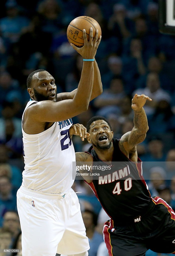 <a gi-track='captionPersonalityLinkClicked' href=/galleries/search?phrase=Al+Jefferson&family=editorial&specificpeople=201604 ng-click='$event.stopPropagation()'>Al Jefferson</a> #25 of the Charlotte Hornets and <a gi-track='captionPersonalityLinkClicked' href=/galleries/search?phrase=Udonis+Haslem&family=editorial&specificpeople=201748 ng-click='$event.stopPropagation()'>Udonis Haslem</a> #40 of the Miami Heat go after a loose ball during game six of the Eastern Conference Quarterfinals of the 2016 NBA Playoffs at Time Warner Cable Arena on April 29, 2016 in Charlotte, North Carolina.