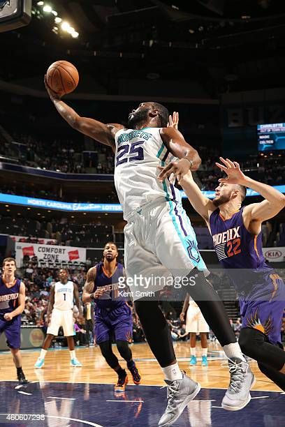 Al Jefferson of the Charlotte Hornets goes up for a shot against the Phoenix Suns during the game at the Time Warner Cable Arena on December 17 2014...