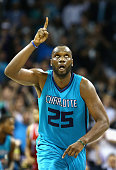 Al Jefferson of the Charlotte Hornets reacts after a shot against the Milwaukee Bucks during their game at Time Warner Cable Arena on October 29 2014...