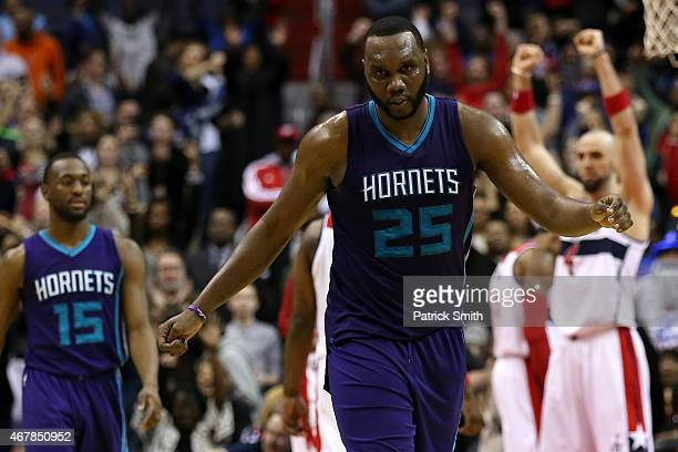 Al Jefferson of the Charlotte Hornets reacts after losing to the the Washington Wizards in double overtime at Verizon Center on March 27 2015 in...