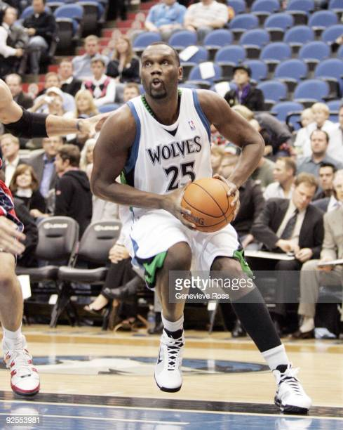 Al Jefferson of the Minnesota Timberwolves drives to the basket against the New Jersey Nets at the Target Center on October 28 2009 in Minneapolis...