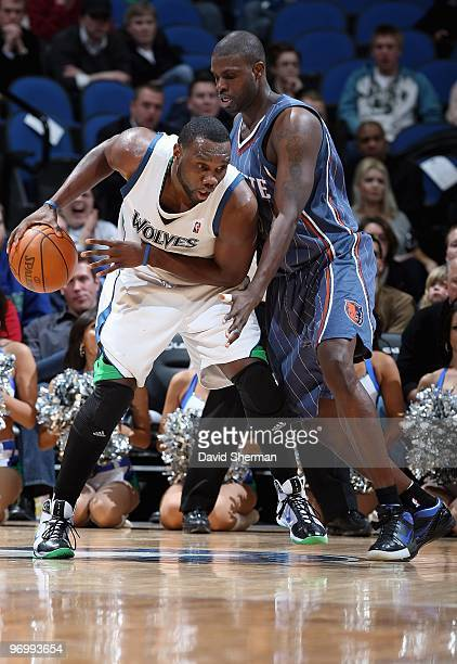 Al Jefferson of the Minnesota Timberwolves handles the ball against Nazr Mohammed of the Charlotte Bobcats during the game on February 10 2010 at the...