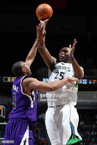 Al Jefferson of the Minnesota Timberwolves shoots against Kenny Thomas of the Sacramento Kings during the game on December 18 2009 at the Target...