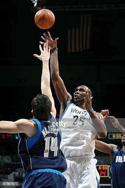Al Jefferson of the Minnesota Timberwolves shoots over Eduardo Najera of the Dallas Mavericks during the game on March 8 2010 at the Target Center in...