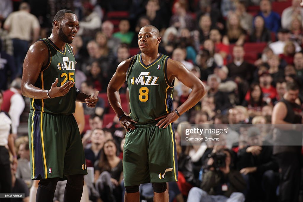 Al Jefferson #25 of the Utah Jazz and Randy Foye #8 of the Utah Jazz confer during the game between the Utah Jazz and the Portland Trail Blazers on February 2, 2013 at the Rose Garden Arena in Portland, Oregon.