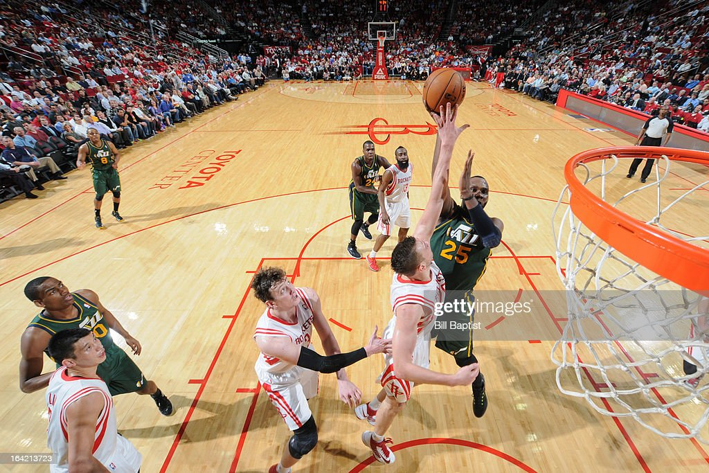 <a gi-track='captionPersonalityLinkClicked' href=/galleries/search?phrase=Al+Jefferson&family=editorial&specificpeople=201604 ng-click='$event.stopPropagation()'>Al Jefferson</a> #25 of the Utah Jazz attempts a shot in the lane against <a gi-track='captionPersonalityLinkClicked' href=/galleries/search?phrase=Donatas+Motiejunas&family=editorial&specificpeople=5561687 ng-click='$event.stopPropagation()'>Donatas Motiejunas</a> #20 of the Houston Rockets on March 20, 2013 at the Toyota Center in Houston, Texas.