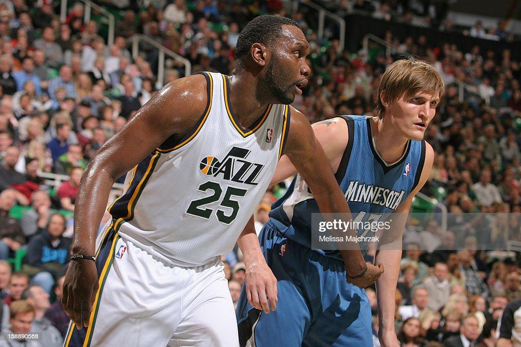 Al Jefferson #25 of the Utah Jazz battles for rebound position against former Jazz teammate Andrei Kirilenko #47 of the Minnesota Timberwolves at Energy Solutions Arena on January 2, 2013 in Salt Lake City, Utah.