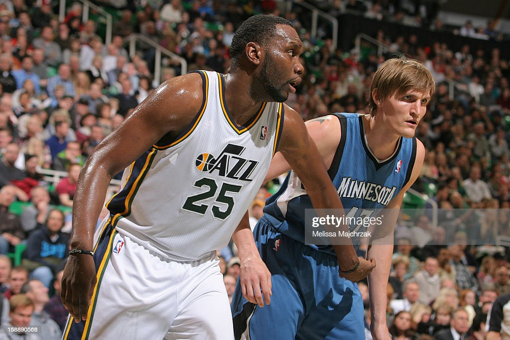 Al Jefferson #25 of the Utah Jazz battles for rebound position against former Jazz teammate Andrei Kirilenko #47 of the Minnesota Timberwolves at Energy Solutions Arena on January 2, 2013 in Salt Lake City, Utah.