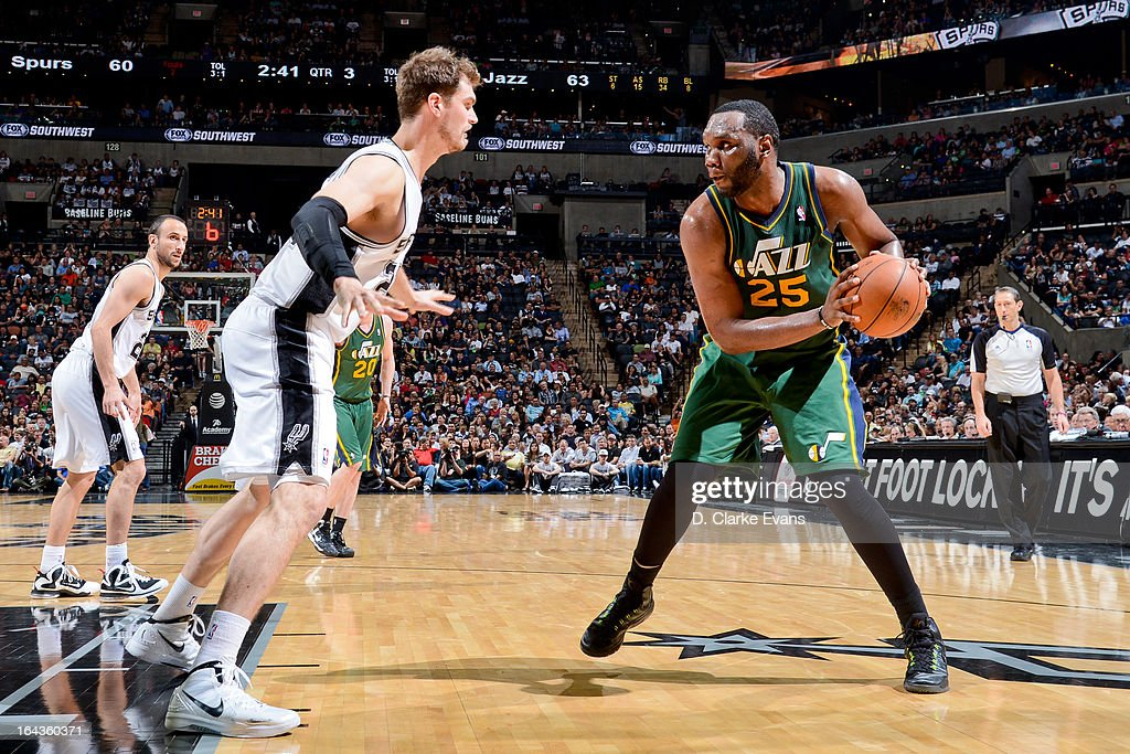 Al Jefferson #25 of the Utah Jazz controls the ball against Tiago Splitter #22 of the San Antonio Spurs on March 22, 2013 at the AT&T Center in San Antonio, Texas.