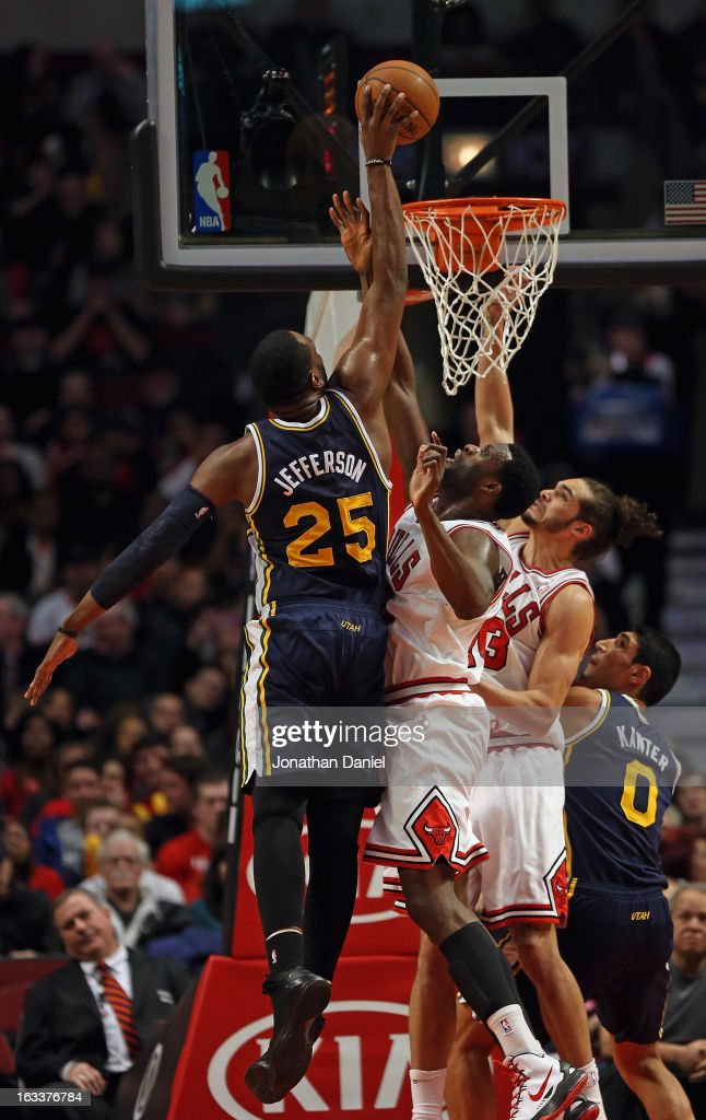 <a gi-track='captionPersonalityLinkClicked' href=/galleries/search?phrase=Al+Jefferson&family=editorial&specificpeople=201604 ng-click='$event.stopPropagation()'>Al Jefferson</a> #25 of the Utah Jazz dinbks over <a gi-track='captionPersonalityLinkClicked' href=/galleries/search?phrase=Nazr+Mohammed&family=editorial&specificpeople=201690 ng-click='$event.stopPropagation()'>Nazr Mohammed</a> #48 and <a gi-track='captionPersonalityLinkClicked' href=/galleries/search?phrase=Joakim+Noah&family=editorial&specificpeople=699038 ng-click='$event.stopPropagation()'>Joakim Noah</a> #13 of the Chicago Bulls at the United Center on March 8, 2013 in Chicago, Illinois.