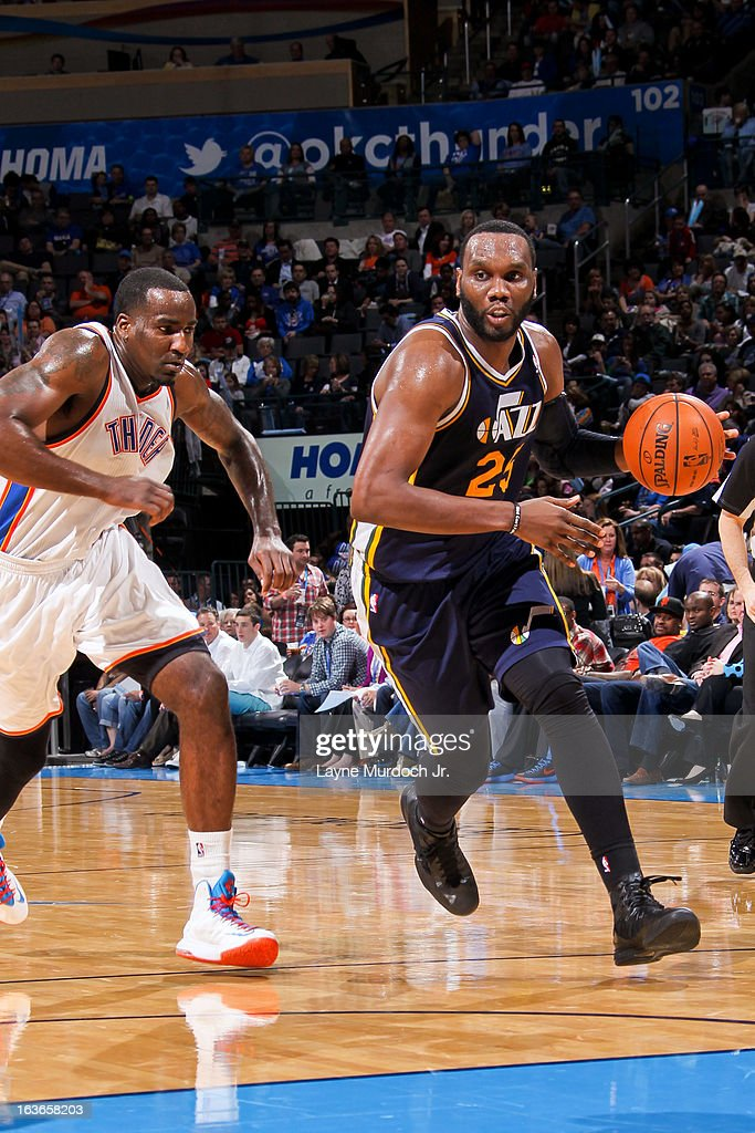 Al Jefferson #25 of the Utah Jazz drives against Kendrick Perkins #5 of the Oklahoma City Thunder on March 13, 2013 at the Chesapeake Energy Arena in Oklahoma City, Oklahoma.