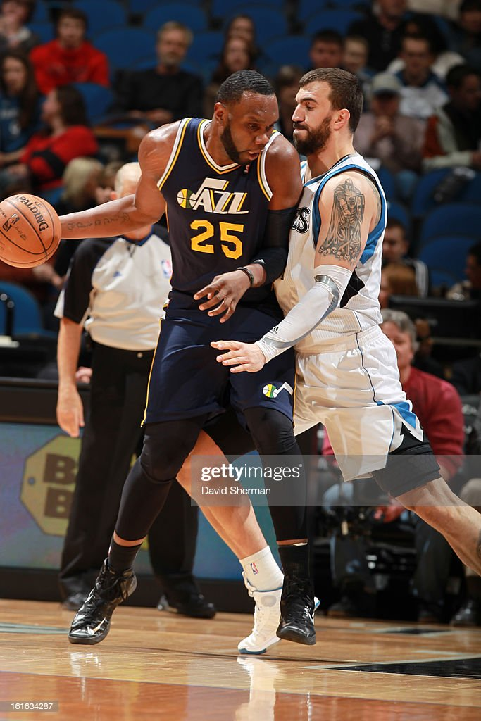 Al Jefferson #25 of the Utah Jazz drives against Nikola Pekovic #14 of the Minnesota Timberwolves on February 13, 2013 at Target Center in Minneapolis, Minnesota.