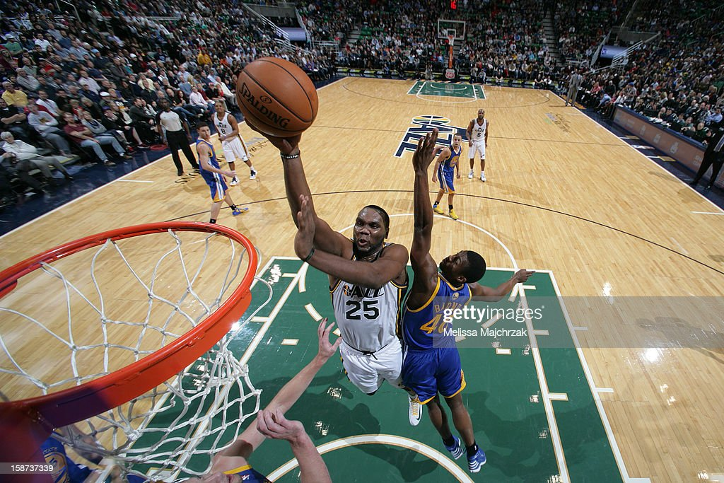 <a gi-track='captionPersonalityLinkClicked' href=/galleries/search?phrase=Al+Jefferson&family=editorial&specificpeople=201604 ng-click='$event.stopPropagation()'>Al Jefferson</a> #25 of the Utah Jazz drives to the basket against <a gi-track='captionPersonalityLinkClicked' href=/galleries/search?phrase=Harrison+Barnes&family=editorial&specificpeople=6893973 ng-click='$event.stopPropagation()'>Harrison Barnes</a> #40 of the Golden State Warriors at Energy Solutions Arena on December 26, 2012 in Salt Lake City, Utah.