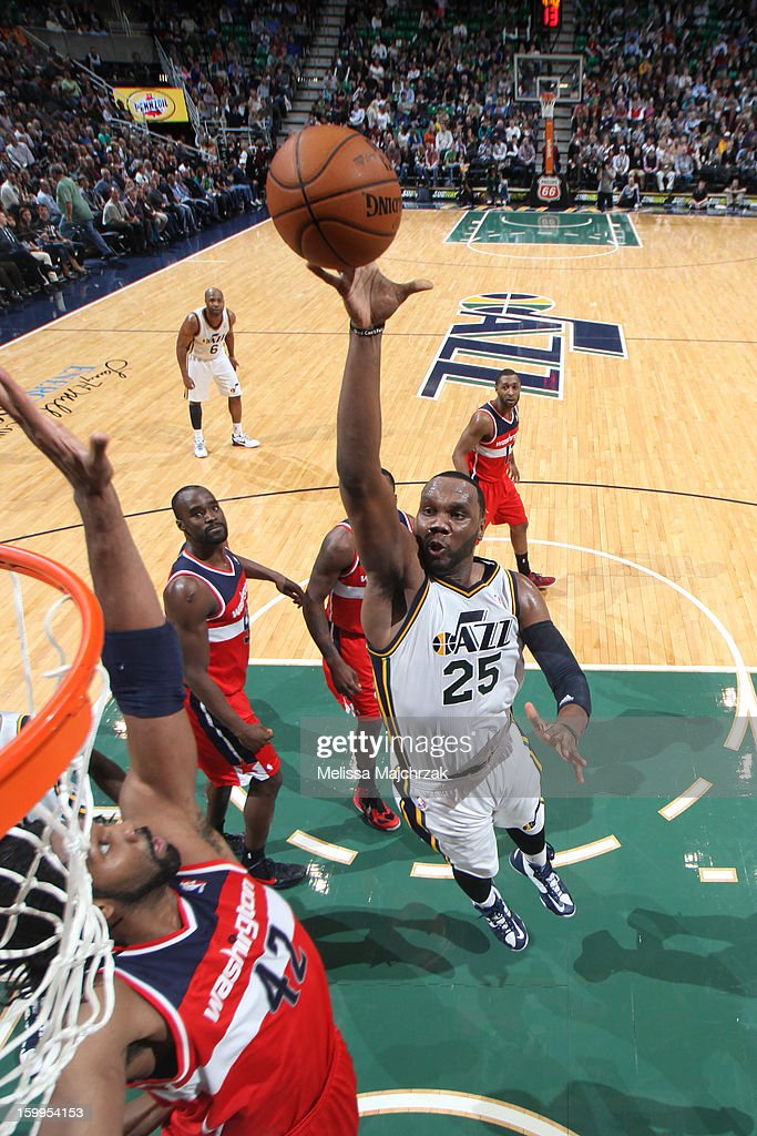 Al Jefferson #25 of the Utah Jazz drives to the basket against Nene #42 of the Washington Wizards at Energy Solutions Arena on January 23, 2013 in Salt Lake City, Utah.