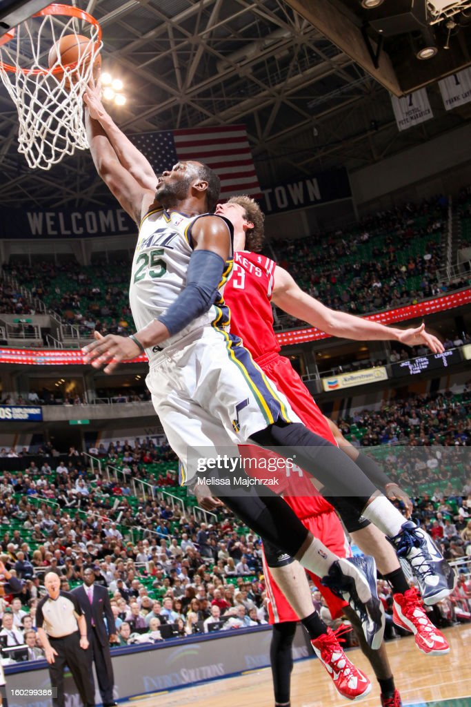 Al Jefferson #25 of the Utah Jazz drives to the basket against Omer Asik #3 of the Houston Rockets at Energy Solutions Arena on January 28, 2013 in Salt Lake City, Utah.
