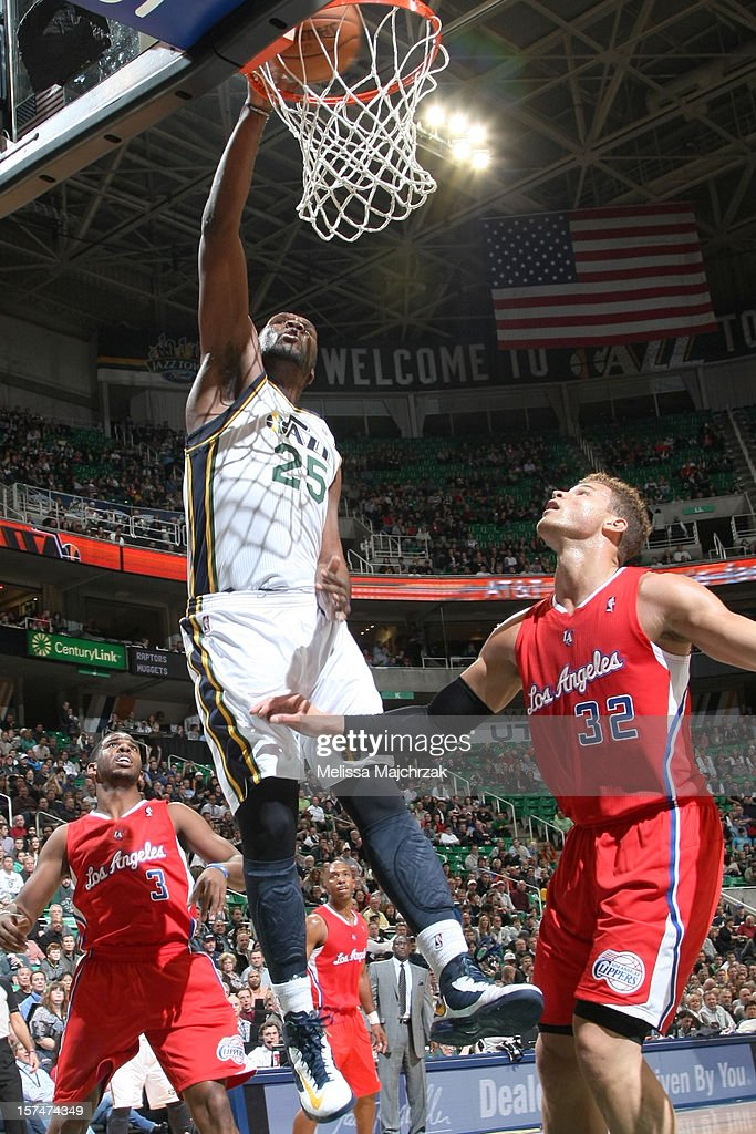 Al Jefferson #25 of the Utah Jazz dunks against Blake Griffin #32 of the Los Angeles Clippers at Energy Solutions Arena on December 03, 2012 in Salt Lake City, Utah.