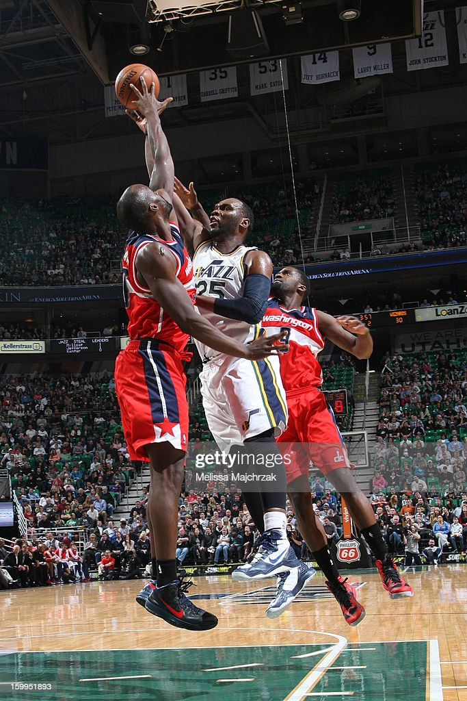 Al Jefferson #25 of the Utah Jazz gets blocked by Emeka Okafor #50 of the Washington Wizards at Energy Solutions Arena on January 23, 2013 in Salt Lake City, Utah.