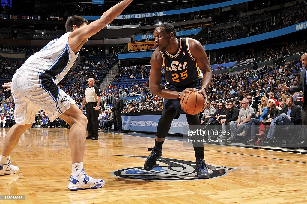 Al Jefferson #25 of the Utah Jazz gets ready to pull the trigger for a shot against the Orlando Magic during the game on December 23, 2012 at Amway Center in Orlando, Florida.