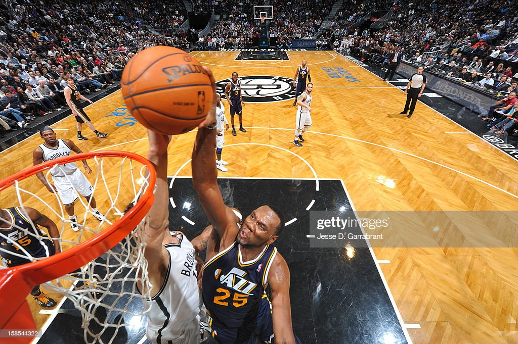 <a gi-track='captionPersonalityLinkClicked' href=/galleries/search?phrase=Al+Jefferson&family=editorial&specificpeople=201604 ng-click='$event.stopPropagation()'>Al Jefferson</a> #25 of the Utah Jazz goes to the basket against <a gi-track='captionPersonalityLinkClicked' href=/galleries/search?phrase=Brook+Lopez&family=editorial&specificpeople=3847328 ng-click='$event.stopPropagation()'>Brook Lopez</a> #11 of the Brooklyn Nets during the game at the Barclays Center on December 18, 2012 in Brooklyn, New York.