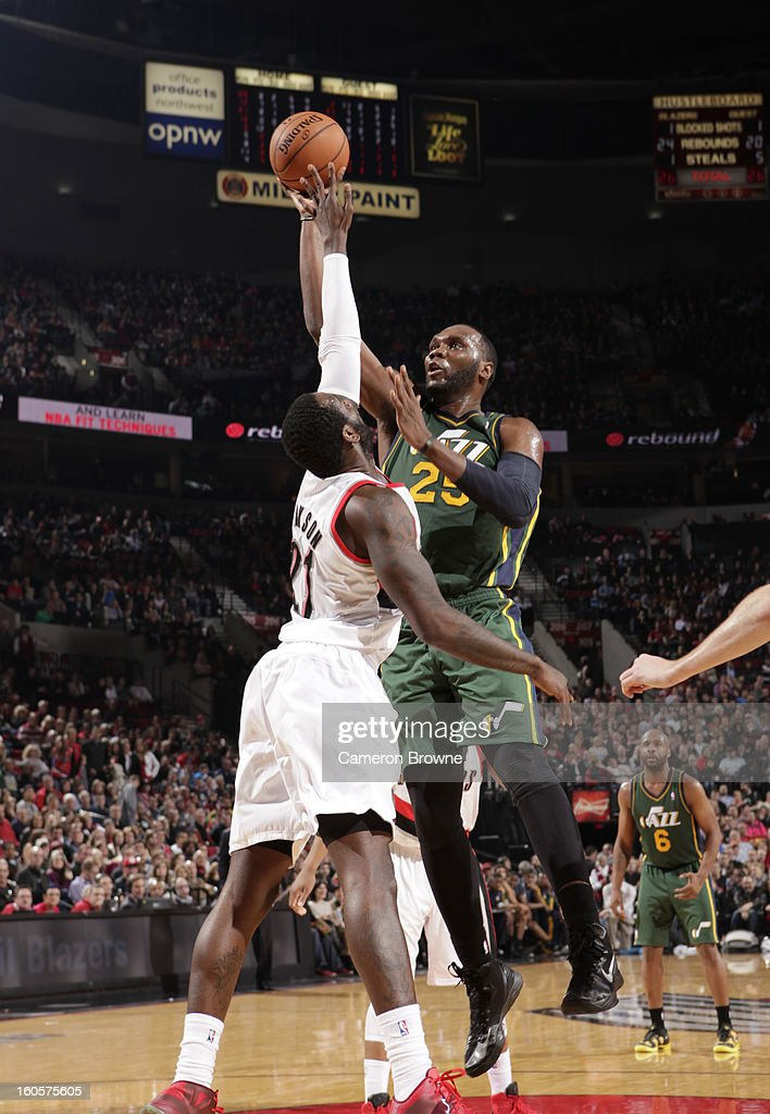 Al Jefferson #25 of the Utah Jazz goes to the basket against J.J. Hickson #21 of the Portland Trail Blazers during the game between the Utah Jazz and the Portland Trail Blazers on February 2, 2013 at the Rose Garden Arena in Portland, Oregon.