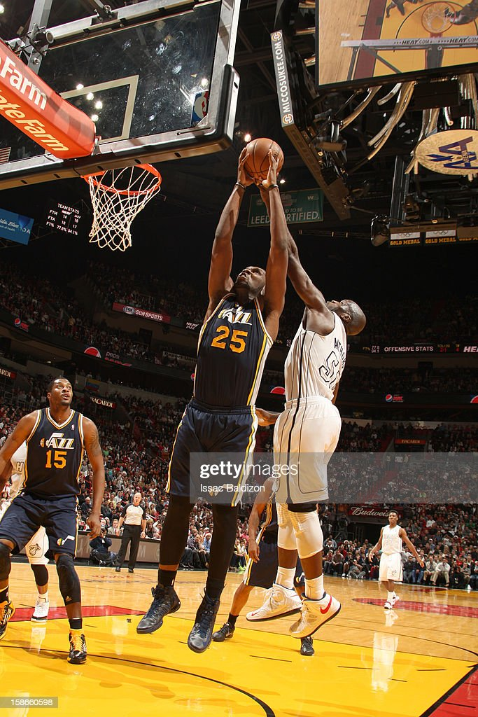 <a gi-track='captionPersonalityLinkClicked' href=/galleries/search?phrase=Al+Jefferson&family=editorial&specificpeople=201604 ng-click='$event.stopPropagation()'>Al Jefferson</a> #25 of the Utah Jazz goes to the basket against <a gi-track='captionPersonalityLinkClicked' href=/galleries/search?phrase=Joel+Anthony&family=editorial&specificpeople=4092295 ng-click='$event.stopPropagation()'>Joel Anthony</a> #50 of the Miami Heat during the game between the Utah Jazz and the Miami Heat on December 22, 2012 at American Airlines Arena in Miami, Florida.