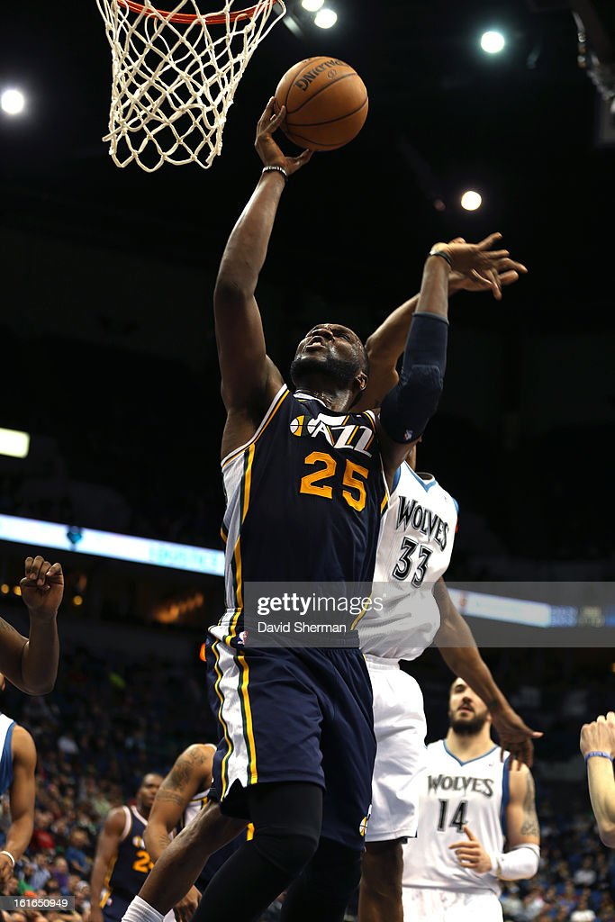 Al Jefferson #25 of the Utah Jazz goes to the basket against the Minnesota Timberwolves on February 13, 2013 at Target Center in Minneapolis, Minnesota.