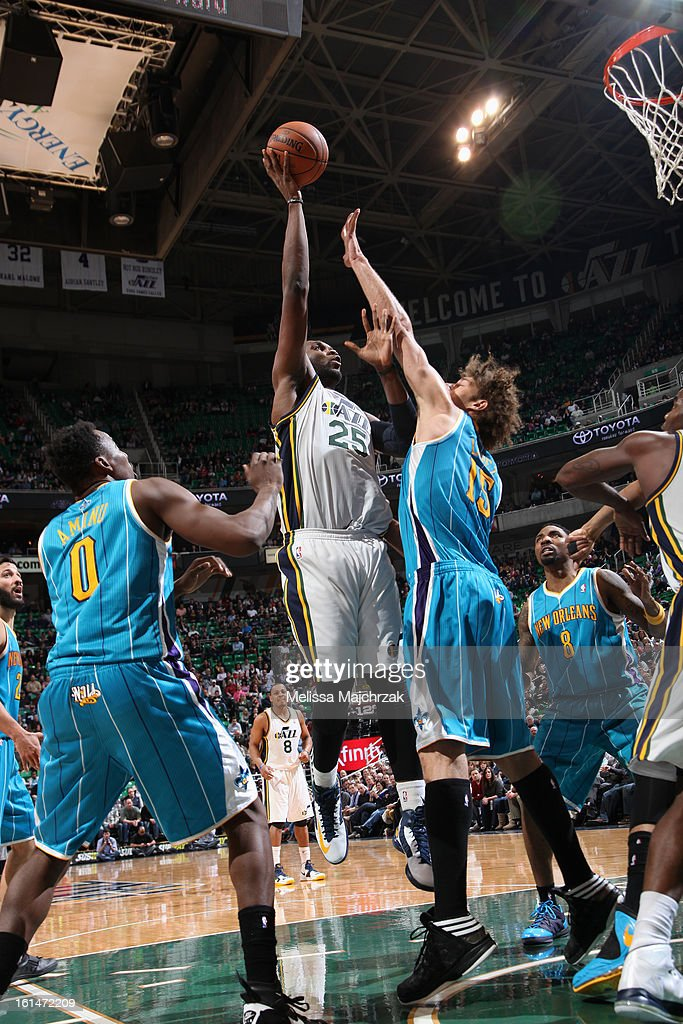 Al Jefferson #25 of the Utah Jazz goes up for a shot against Robin Lopez #15 of the New Orleans Hornets at Energy Solutions Arena on January 30, 2013 in Salt Lake City, Utah.