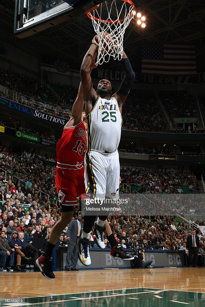 Al Jefferson #25 of the Utah Jazz goes up for the dunk against Joakim Noah #13 of the Chicago Bulls at Energy Solutions Arena on February 08, 2013 in Salt Lake City, Utah.