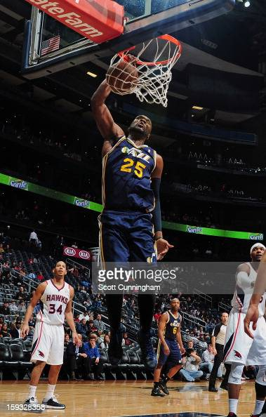 Al Jefferson of the Utah Jazz goes up for the dunk against the Atlanta Hawks on January 11 2013 at Philips Arena in Atlanta Georgia NOTE TO USER User...