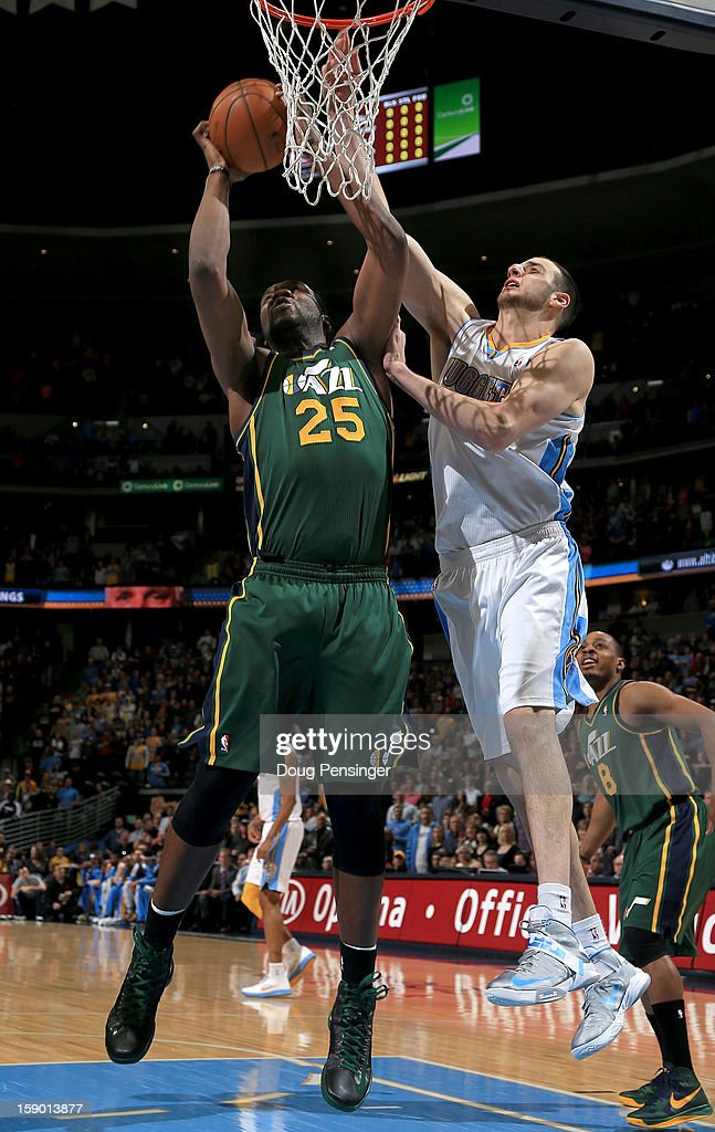 Al Jefferson #25 of the Utah Jazz grabs a rebound away from Kosta Koufos #41 of the Denver Nuggets at the Pepsi Center on January 5, 2013 in Denver, Colorado.
