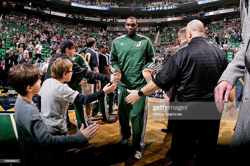 Al Jefferson #25 of the Utah Jazz greets fans before playing against the Minnesota Timberwolves at Energy Solutions Arena on January 2, 2013 in Salt Lake City, Utah.
