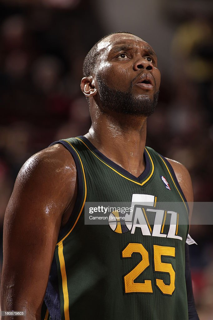 Al Jefferson #25 of the Utah Jazz looks at the scoreboard during the game between the Utah Jazz and the Portland Trail Blazers on February 2, 2013 at the Rose Garden Arena in Portland, Oregon.