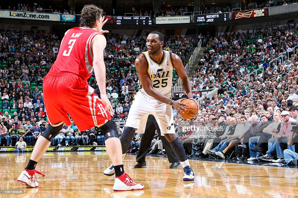 Al Jefferson #25 of the Utah Jazz looks to drive against Omer Asik #3 of the Houston Rockets at Energy Solutions Arena on November 19, 2012 in Salt Lake City, Utah.