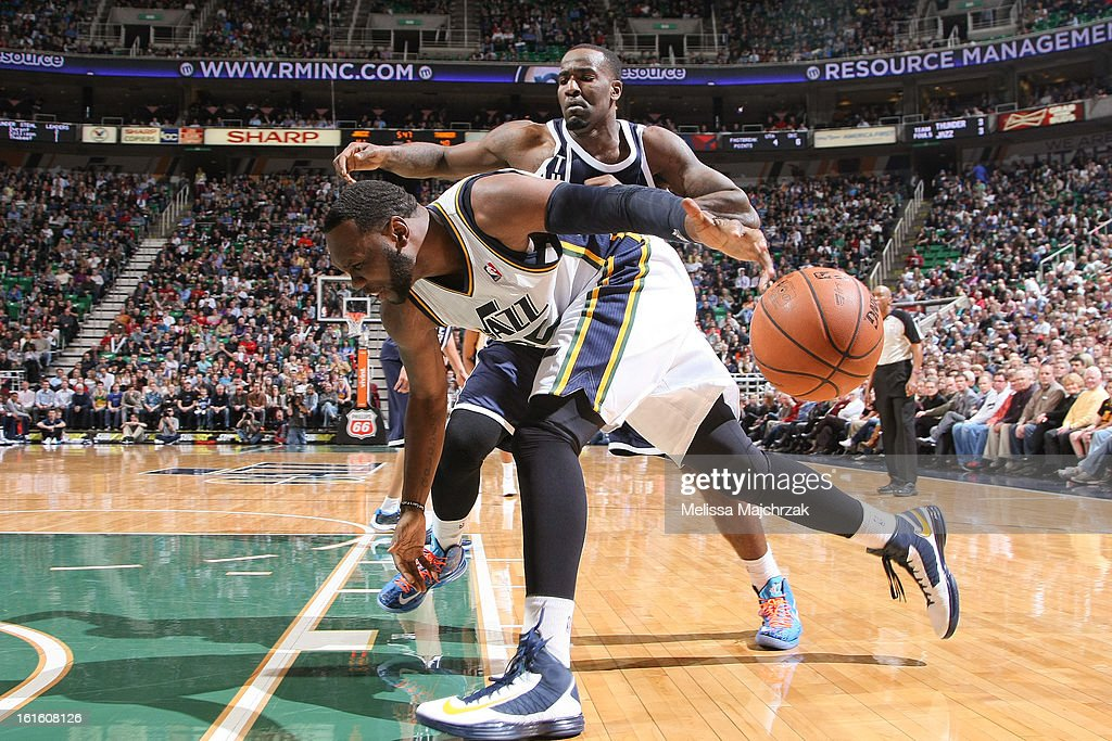 Al Jefferson #25 of the Utah Jazz loses control of the ball while driving against Kendrick Perkins #5 of the Oklahoma City Thunder at Energy Solutions Arena on February 12, 2013 in Salt Lake City, Utah.