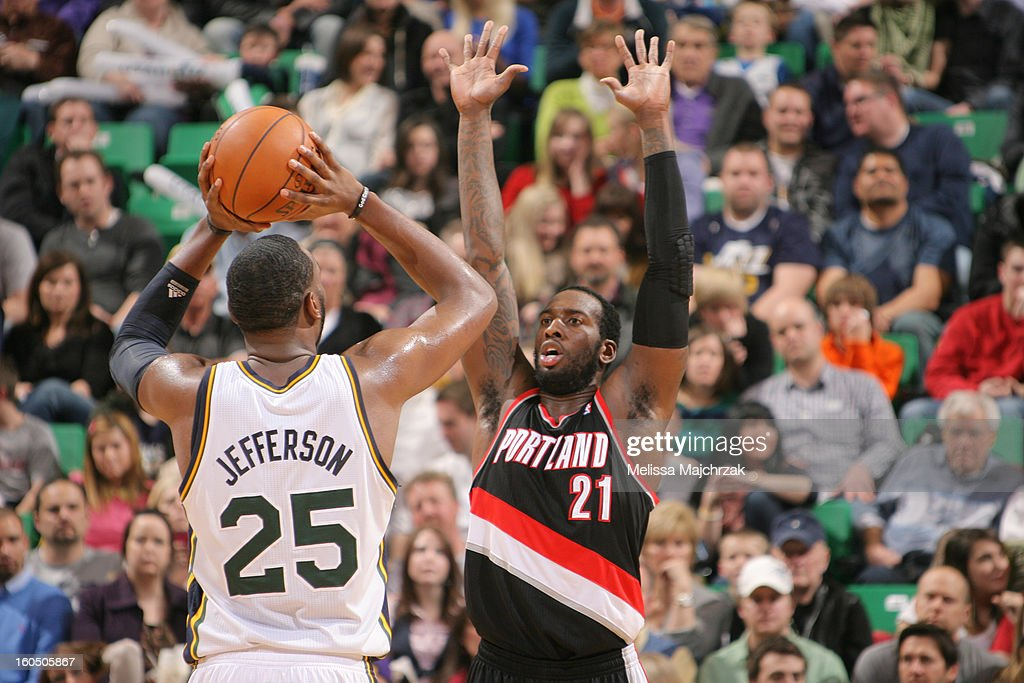 <a gi-track='captionPersonalityLinkClicked' href=/galleries/search?phrase=Al+Jefferson&family=editorial&specificpeople=201604 ng-click='$event.stopPropagation()'>Al Jefferson</a> #25 of the Utah Jazz passes against <a gi-track='captionPersonalityLinkClicked' href=/galleries/search?phrase=J.J.+Hickson&family=editorial&specificpeople=4226173 ng-click='$event.stopPropagation()'>J.J. Hickson</a> #21 of the Portland Trail Blazers at Energy Solutions Arena on February 01, 2013 in Salt Lake City, Utah.