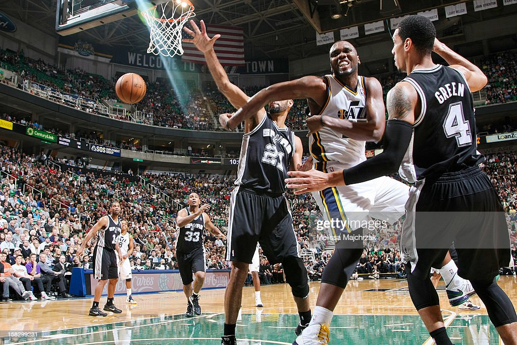 <a gi-track='captionPersonalityLinkClicked' href=/galleries/search?phrase=Al+Jefferson&family=editorial&specificpeople=201604 ng-click='$event.stopPropagation()'>Al Jefferson</a> #25 of the Utah Jazz passes in the lane against <a gi-track='captionPersonalityLinkClicked' href=/galleries/search?phrase=Tim+Duncan&family=editorial&specificpeople=201467 ng-click='$event.stopPropagation()'>Tim Duncan</a> #21 and Danny Green #4 of the San Antonio Spurs at Energy Solutions Arena on December 12, 2012 in Salt Lake City, Utah.