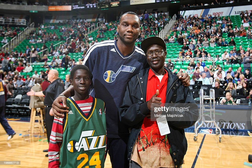 Al Jefferson #25 of the Utah Jazz poses with fans before his team's game against the Sacramento Kings at Energy Solutions Arena on November 23, 2012 in Salt Lake City, Utah.