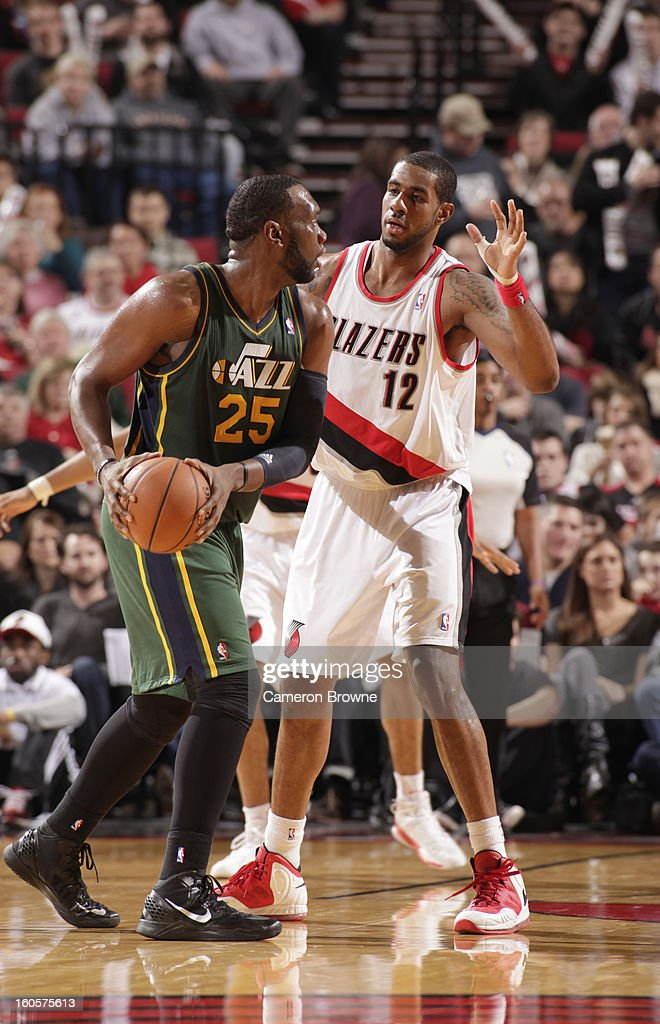 Al Jefferson #25 of the Utah Jazz protects the ball from LaMarcus Aldridge #12 of the Portland Trail Blazers during the game between the Utah Jazz and the Portland Trail Blazers on February 2, 2013 at the Rose Garden Arena in Portland, Oregon.