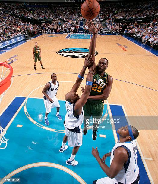 Al Jefferson of the Utah Jazz puts up the hook shot against Lamar Odom of the Dallas Mavericks on January 27 2012 at the American Airlines Center in...