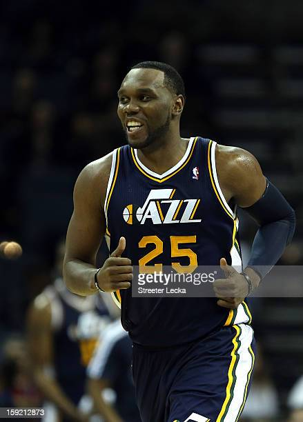 Al Jefferson of the Utah Jazz reacts after his team scores a basket against the Charlotte Bobcats during their game at Time Warner Cable Arena on...