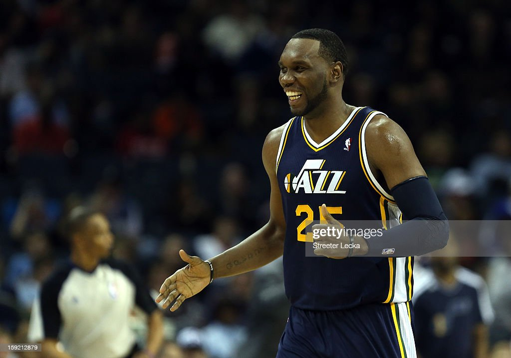 Al Jefferson #25 of the Utah Jazz reacts after his team scores a basket against the Charlotte Bobcats during their game at Time Warner Cable Arena on January 9, 2013 in Charlotte, North Carolina.