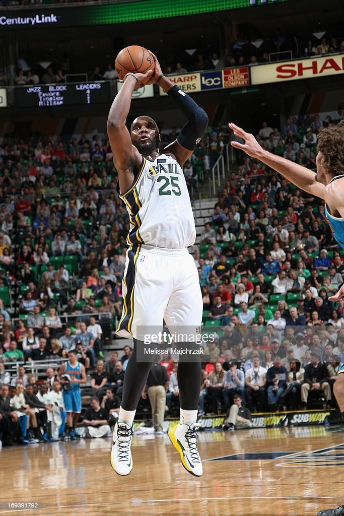Al Jefferson #25 of the Utah Jazz shoots a jumper against the New Orleans Hornets at Energy Solutions Arena on April 5, 2013 in Salt Lake City, Utah.