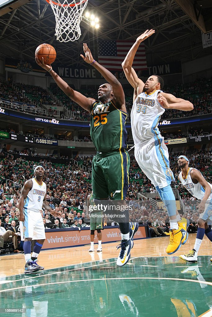 <a gi-track='captionPersonalityLinkClicked' href=/galleries/search?phrase=Al+Jefferson&family=editorial&specificpeople=201604 ng-click='$event.stopPropagation()'>Al Jefferson</a> #25 of the Utah Jazz shoots a layup against <a gi-track='captionPersonalityLinkClicked' href=/galleries/search?phrase=JaVale+McGee&family=editorial&specificpeople=4195625 ng-click='$event.stopPropagation()'>JaVale McGee</a> #34 of the Denver Nuggets at Energy Solutions Arena on November 26, 2012 in Salt Lake City, Utah.