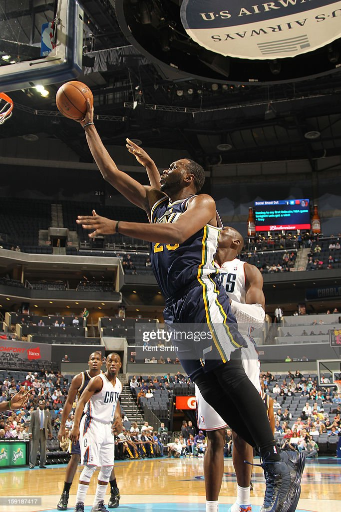 Al Jefferson #25 of the Utah Jazz shoots against Bismack Biyombo #0 of the Charlotte Bobcats at the Time Warner Cable Arena on January 9, 2013 in Charlotte, North Carolina.