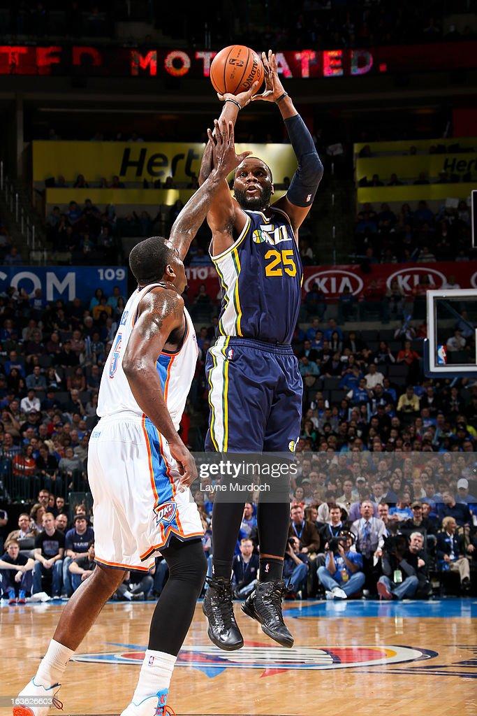 Al Jefferson #25 of the Utah Jazz shoots against Kendrick Perkins #5 of the Oklahoma City Thunder on March 13, 2013 at the Chesapeake Energy Arena in Oklahoma City, Oklahoma.