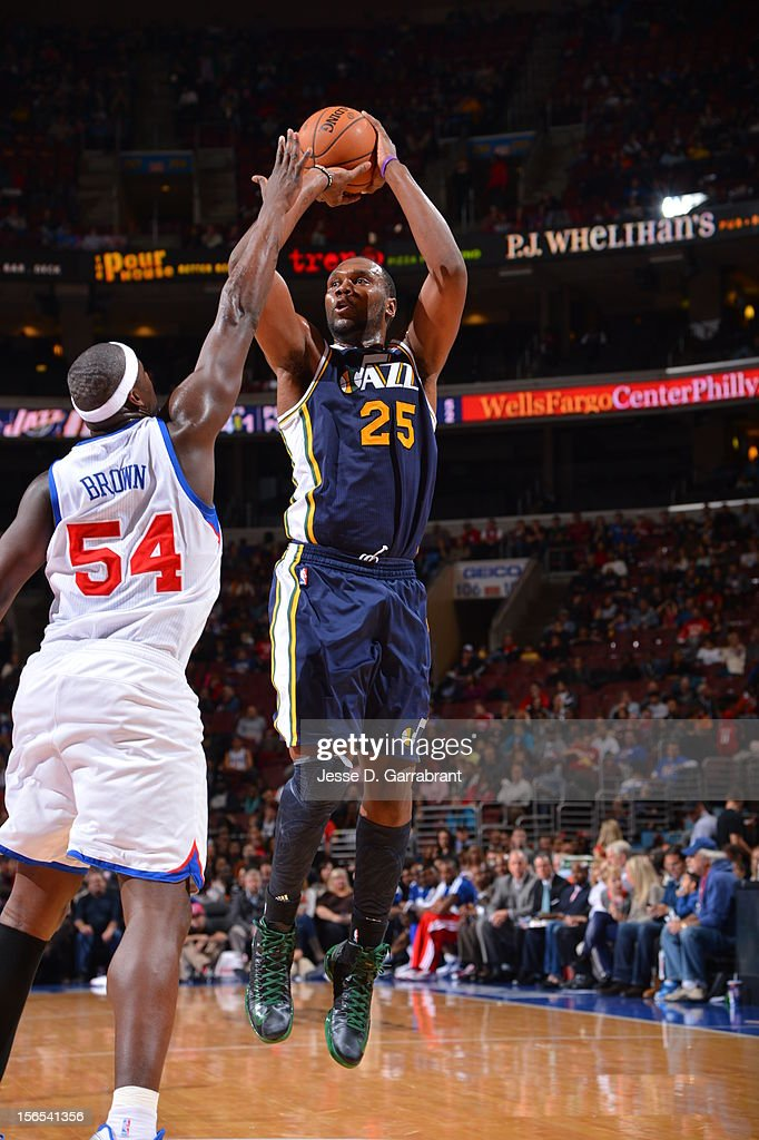 Al Jefferson #25 of the Utah Jazz shoots against Kwame Brown #54 of the Philadelphia 76ers at the Wells Fargo Center on November 16, 2012 in Philadelphia, Pennsylvania.