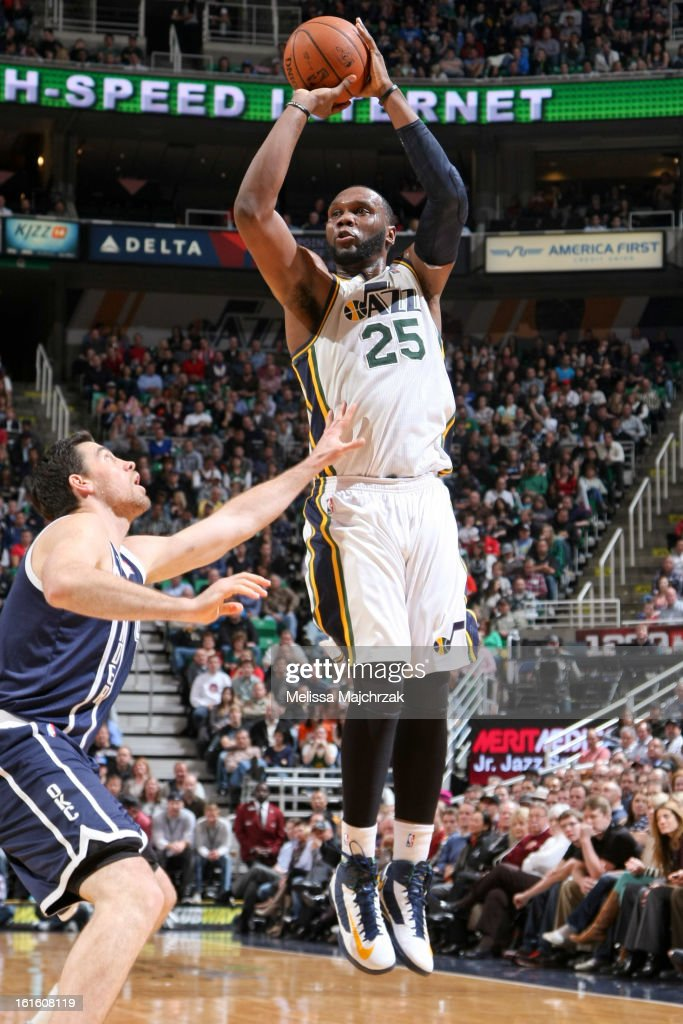 Al Jefferson #25 of the Utah Jazz shoots against Nick Collison #4 of the Oklahoma City Thunder of the Utah Jazz of the Oklahoma City Thunder at Energy Solutions Arena on February 12, 2013 in Salt Lake City, Utah.