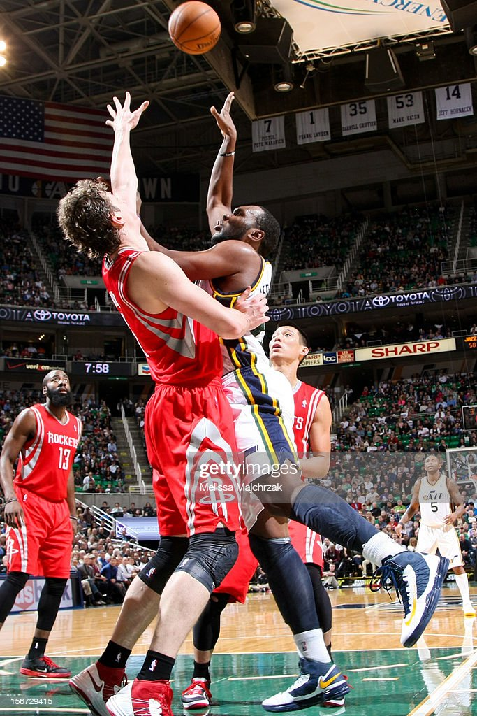 Al Jefferson #25 of the Utah Jazz shoots against Omer Asik #3 of the Houston Rockets at Energy Solutions Arena on November 19, 2012 in Salt Lake City, Utah.